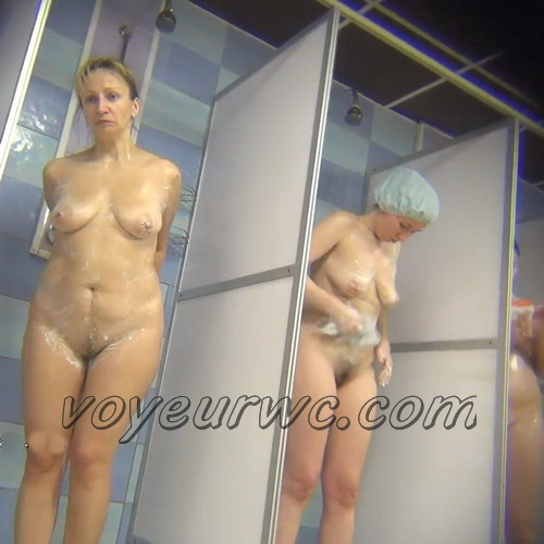 A hidden camera in a public shower films gorgeous women while they soap up their bodies (Hidden Camera Public Shower 78-90)