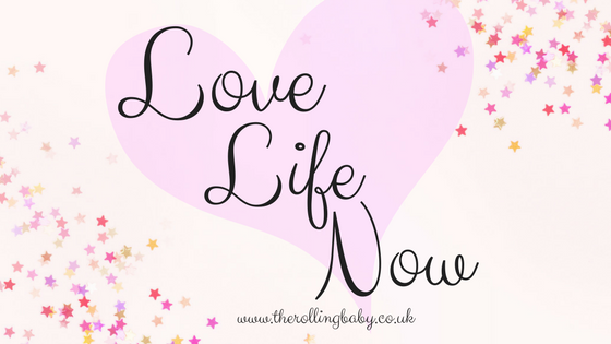 Pale pink background with multi coloured stars in the corner and a darker pink heart in the centre