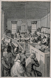 A fine etching depicting the Old Bailey Courtroom, complete with observers and clerk in the foreground and judge and prisoners in the background. The wood panelling and stepped seating associated with a courtroom are visible, with tall curtained windows on the far wall.