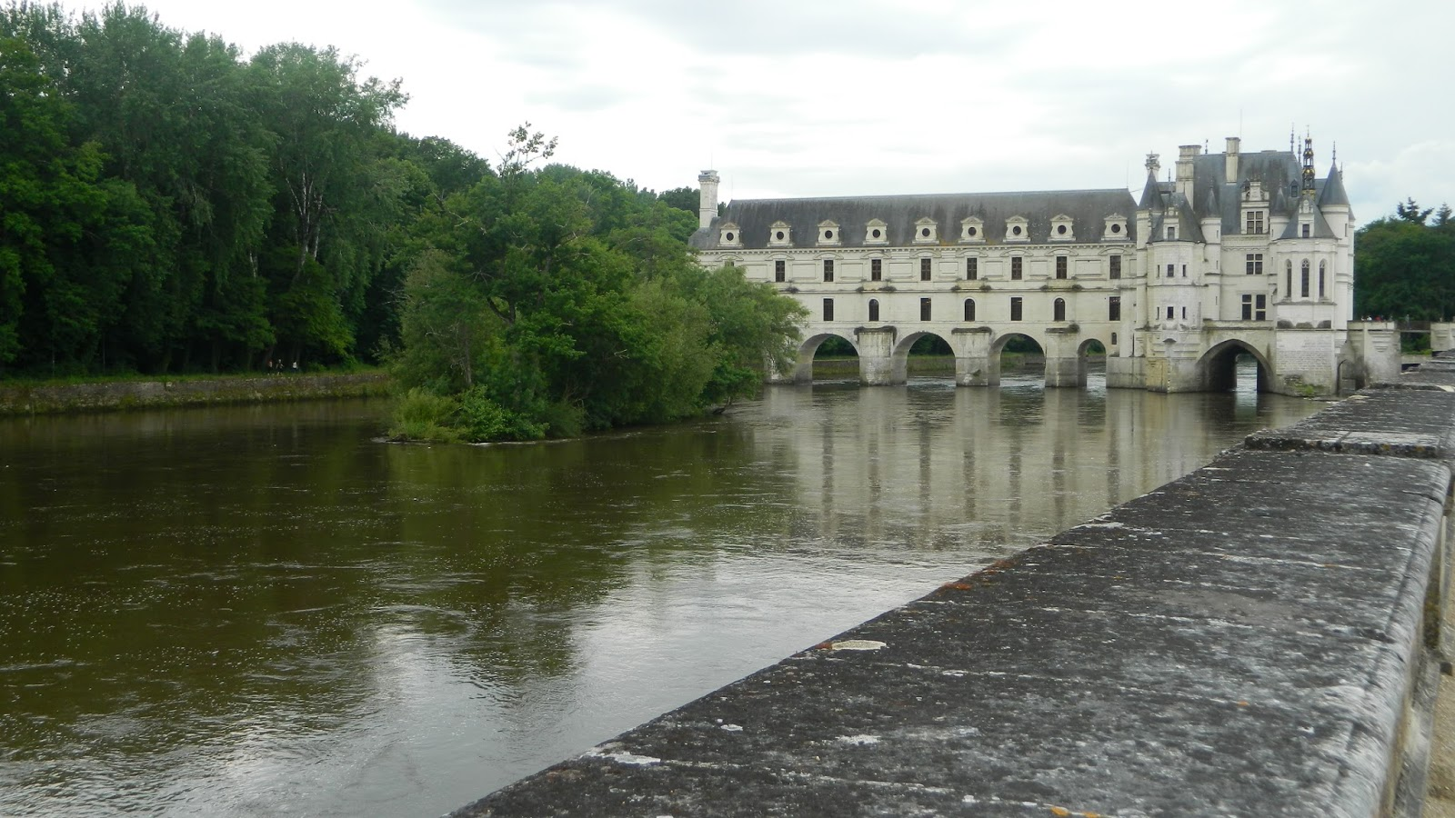 It Gracefully Straddles The River Cher In Loire Valley Region Of France