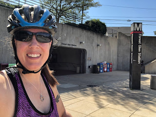 Photo of Jean in a bike helmet in front of the Forest Glen Metro station entrance