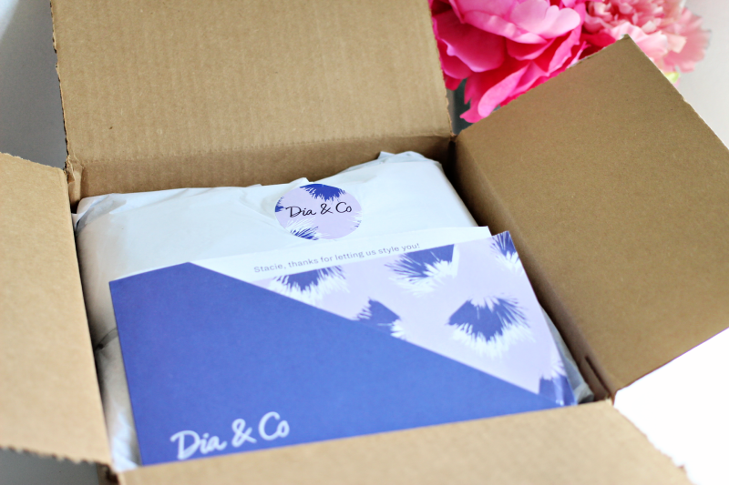 unboxing a Dia & Co plus-size subscription box on a white table
