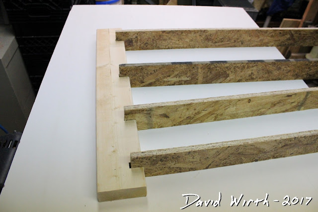 wood and pvc shelf for basement paint cans, spray paint, caulk tubes