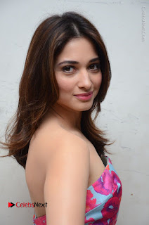 Actress Tamanna Latest Images in Floral Short Dress at Okkadochadu Movie Promotions  0134.JPG