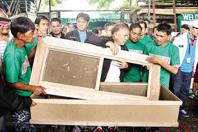 Drug surrenders in Olongo become casket makers