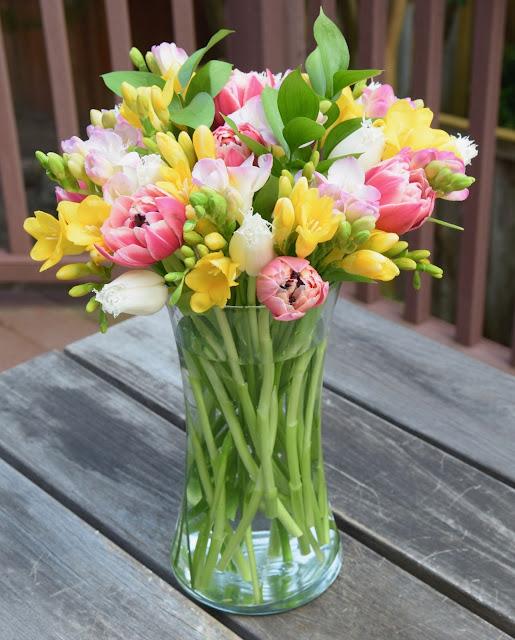 Tulips and freesias flower arrangement