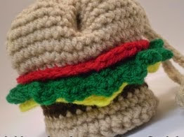 http://www.ravelry.com/patterns/library/mini-hamburger-drawstring-bag