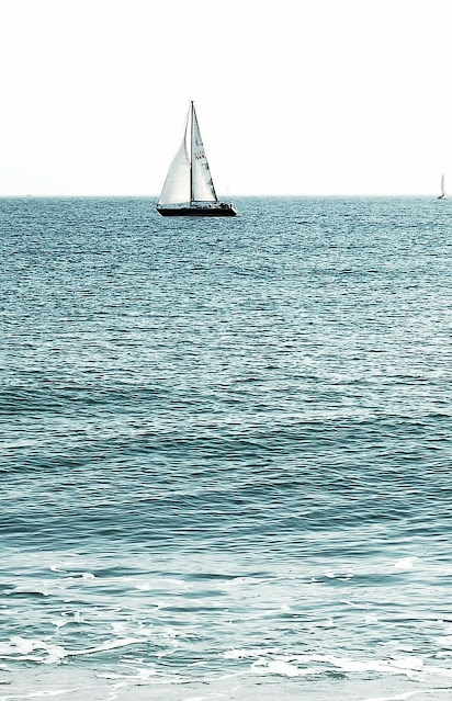 sailboat on a tranquil sea