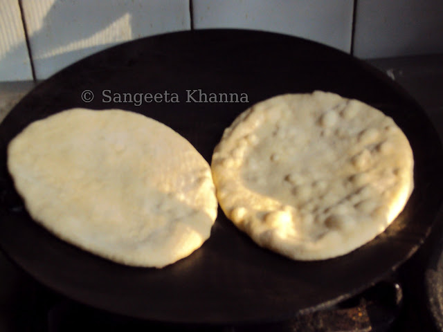 whole wheat naan being baked on griddle