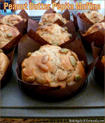 Peanut Butter Pepita Muffins, peanut butter flavored muffins with a hint of honey and the crunch of pepitas.   Recipe developed by www.BakingInATornado.com   #recipe #bake