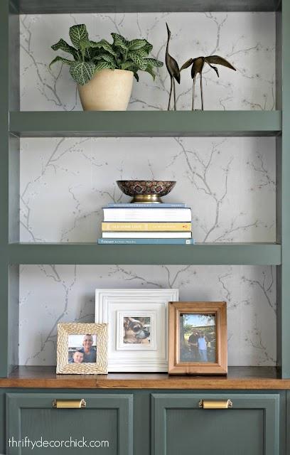 Green bookcases cherry blossom wallpaper