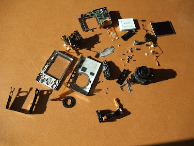 disassembled SD770is canon camera, all pieces, parts