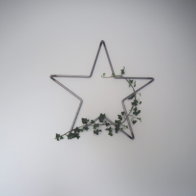 Metal star with some greenery wrapped around it to add a bit of serenity