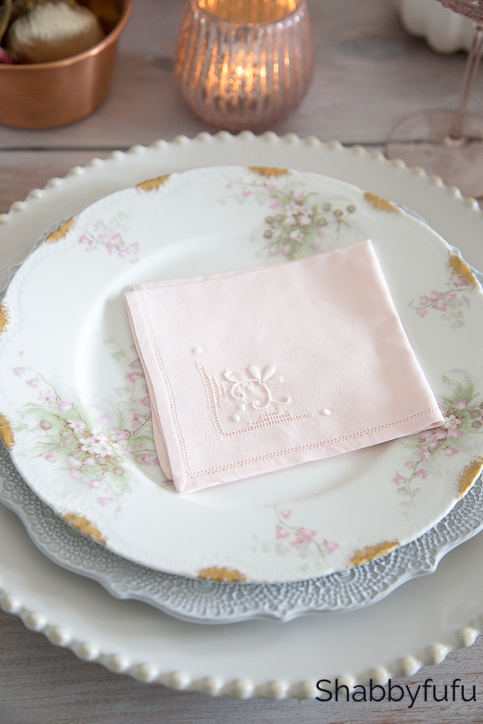 vintage plate stack with a pink napkin