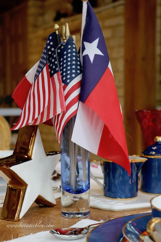Labor Day patriotic French Country table setting with Texas flag and American flags as centerpiece