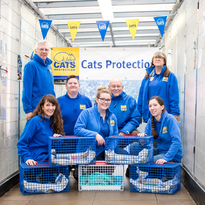 a group of Cats Protection volunteers with cat baskets