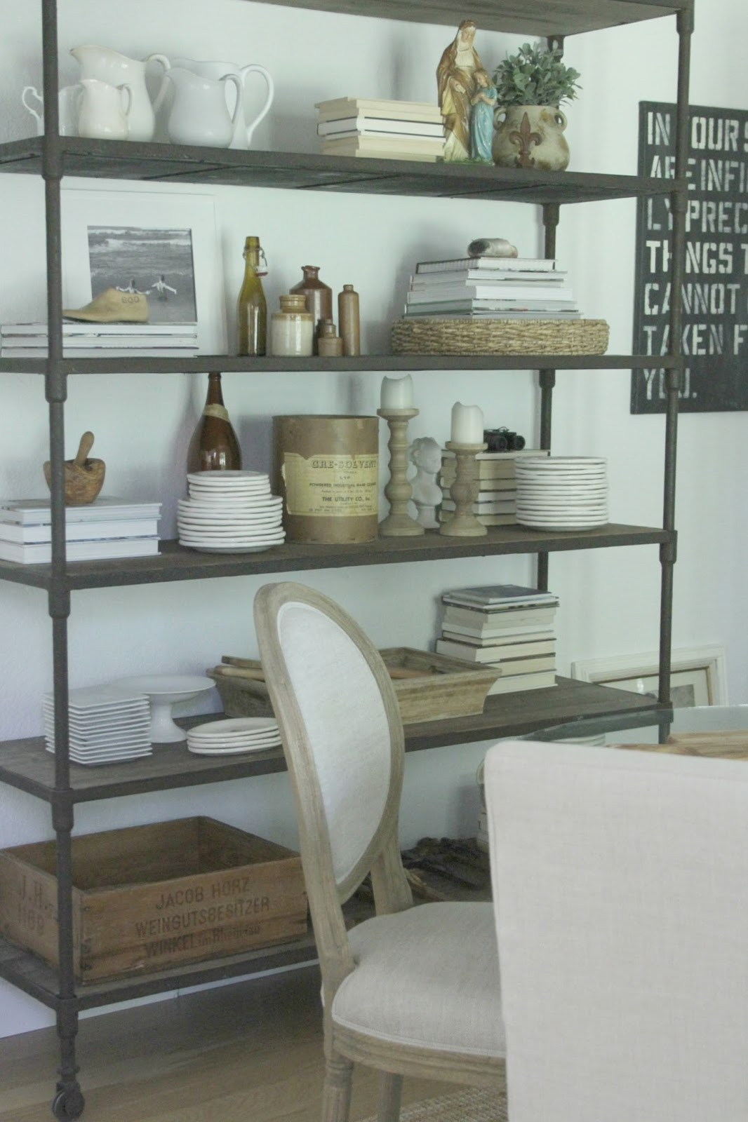 Rustic decor and vintage treasures on reclaimed wood shelves in dining room. #belgianstyle #etagere #diningroom #belgianlinen