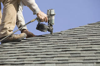 Nail gun doing roofing work demonstrating PSI vs. CFM