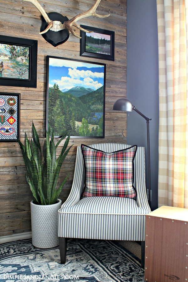 At Home Stores, Blue and White Striped Chair, mountain painting artwork, wood fence plank wall, antlers mount, vintage paint by number picture