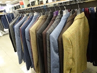 rack of stunning mens suits slaters