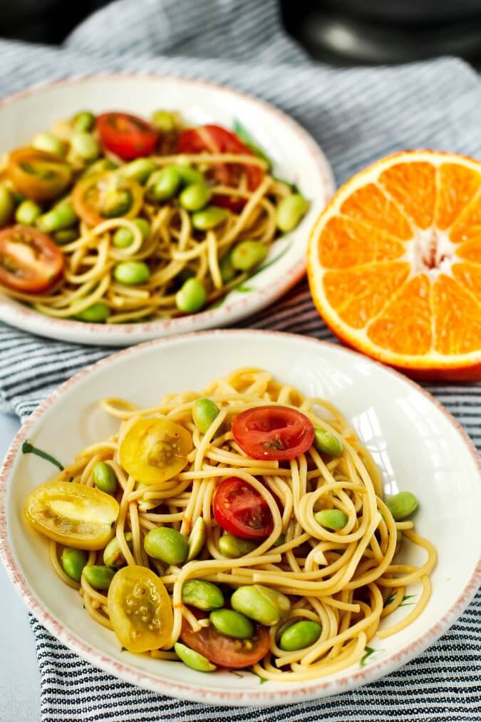 Edamame noodle salad in bowls with orange dressing