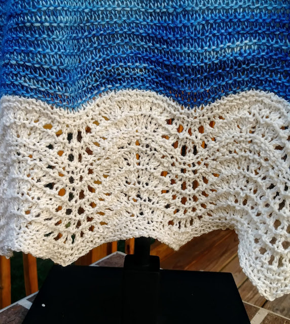 lace detail on a simple garter stitch prayer shawl