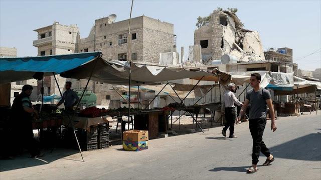 Informe: Sanciones empujan a sirios cansados de guerra a pobreza