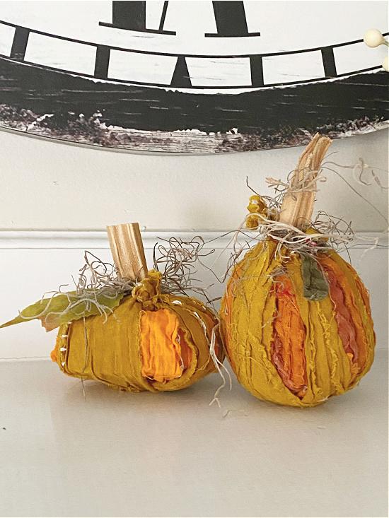 rag pumpkins on mantel