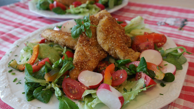 Salad Topped with Breaded Chicken Strips