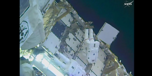 Kimbrough, top, and Whitson work to attached the adapter plates on the 3A power channel. Photo Credit: NASA TV