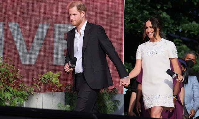 Meghan Markle wore a new floral-embellished mini shift dress by Valentino. Prince Harry