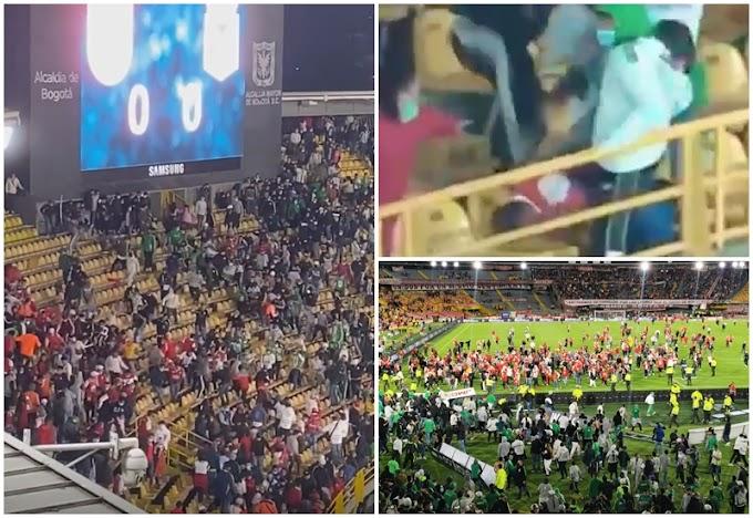 ¡Vergüenza en El Campín! 'Batalla campal' entre hinchas de Atlético Nacional y Santa Fe tiene a un hombre al borde de la muerte