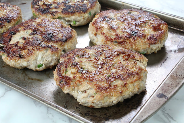 Cooked ground pork patties