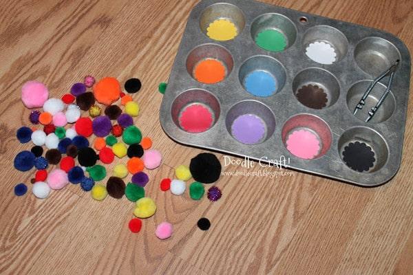Pom pom color match preschooler game using a cupcake tin