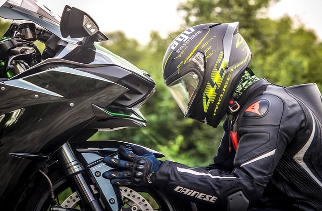 man checking his motorcycle