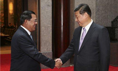 Samdech Techo Hun Sèn et Xi Jinping lors de sa visite au Cambodge en 2016