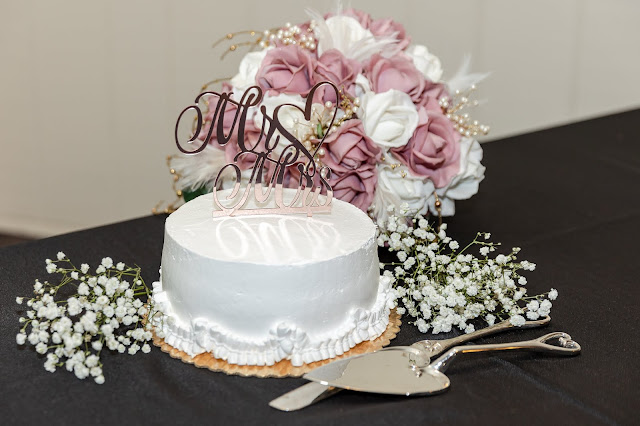 white single layer wedding cake with mr & mrs topper
