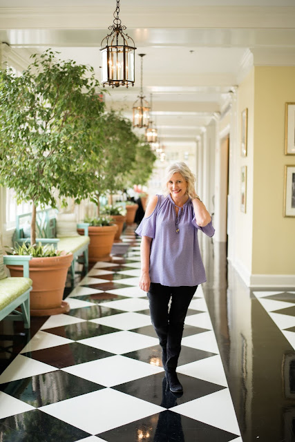 NC Blogger Leigh Powell HInes at the Beautiful HIstoric Carolina Inn in Chapel Hill, NC. This Black and White Hallway is an Inn landmark. Leigh shares her weight loss journey before turning 50. She lost 20 pounds.