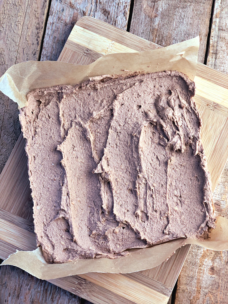 A super easy keto fudge recipe with the chocolate and nut flavors you crave. The perfect low carb treat all whipped up in just a few minutes! #keto #lowcarb #sugarfree #fudge #chocolate #macadamia #nut #dessert #recipe | bobbiskozykitchen.com