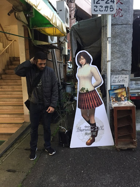 Ryo being typically awkward around Nozomi! Taken outside Hanamatsu florist (image via the project's Twitter account).