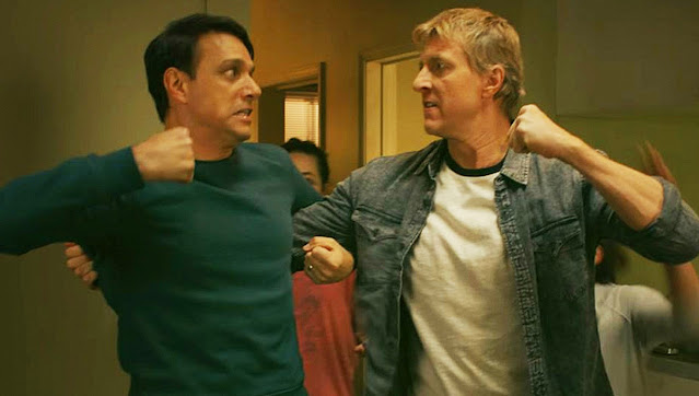 Image of Daniel and Johnny fighting