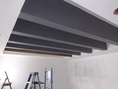 five ceilings beams primed and ready to paint