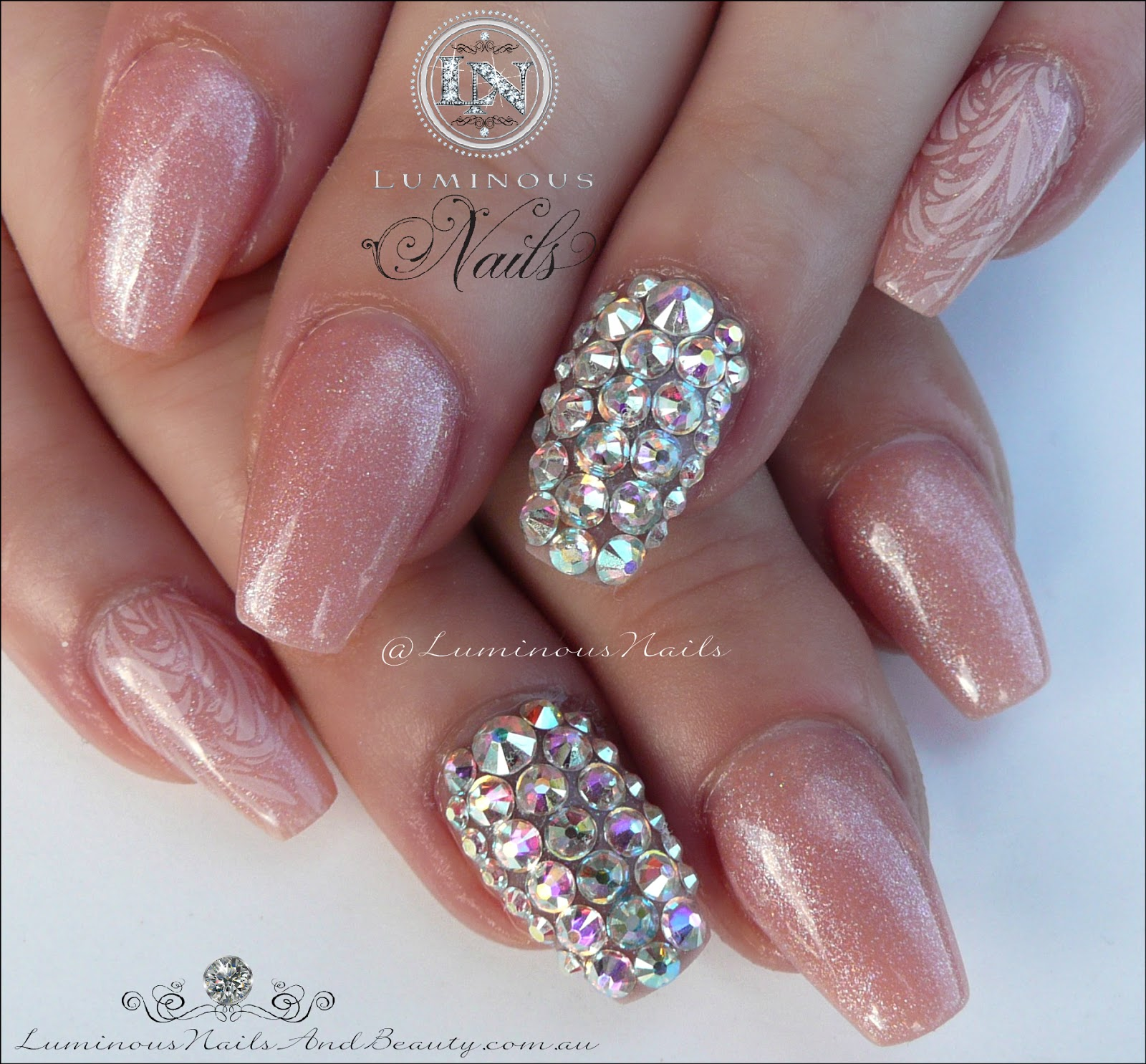 Luminous Nails: Shimmery Nude Acrylic Nails with Swarovski Crystals
