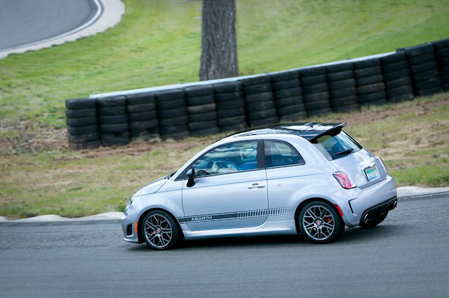 Silver Fiat 500 Abarth on race track