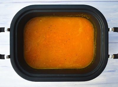 Blended carrot soup in slow cooker