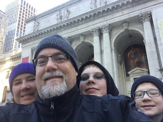 David Brodosi and family in front of New York Library
