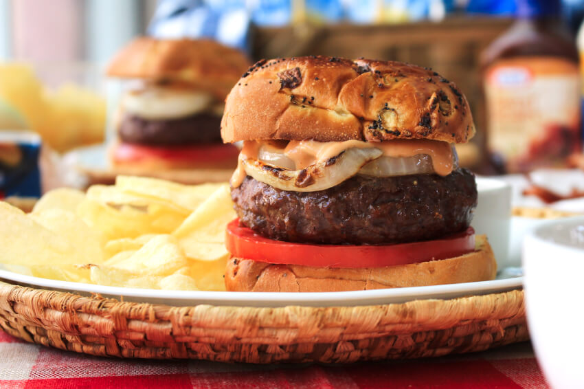 Bacon and Cheese Stuffed BBQ Burgers will be the highlight of your next barbecue!  These juicy burgers stuffed with American cheese and bacon are topped with grilled onions and a zesty barbecue mayo burger sauce.  #ad #burgers #grill @Heinz @Kraft
