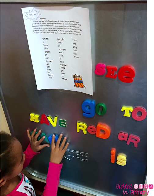 magnetic board with student spelling words with magnets