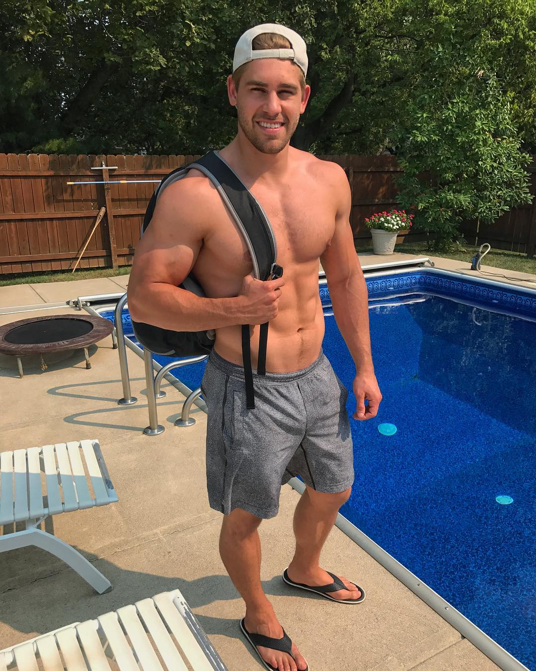 young-fit-shirtless-college-dude-smiling-pool