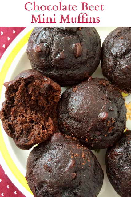 Chocolate beet mini muffins on a plate with one with a bite out.